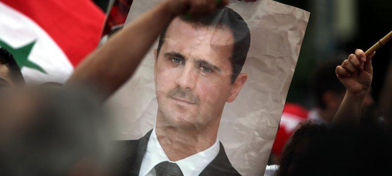 Bild von Baschar al-Assad auf einer Syrien-Demonstration